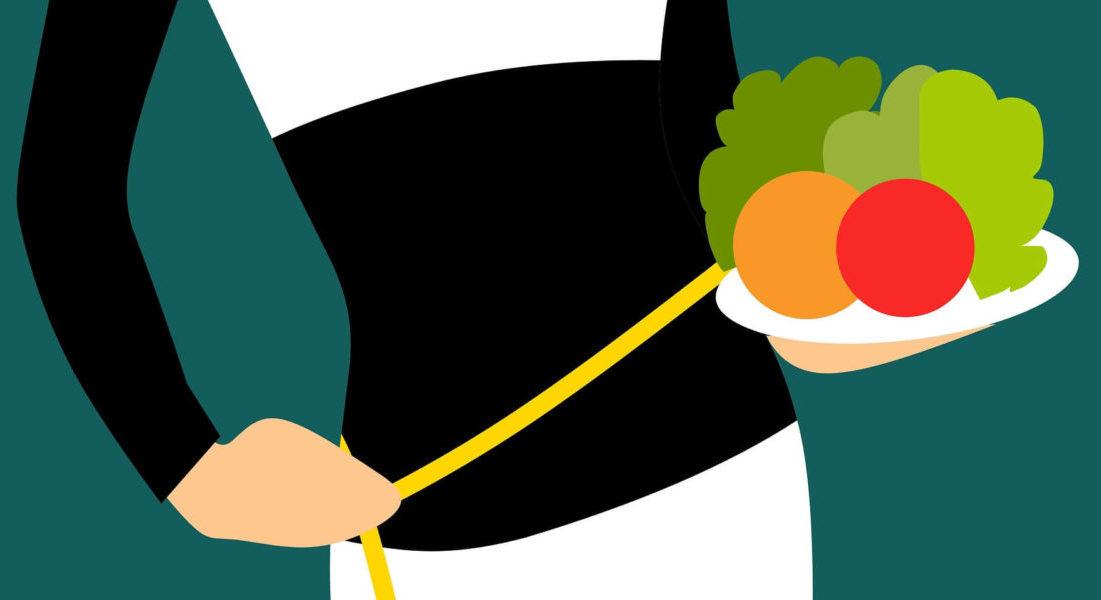 ダイエットで減量した女性のウエスト周りと野菜